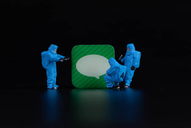 Workers in protective clothes with message app symbol