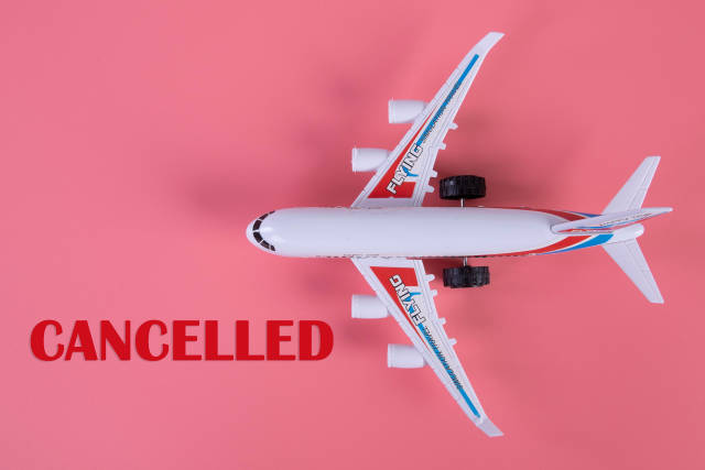 Small airplane with Candelled text on pink background