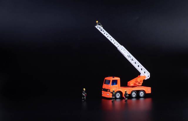 Ladder fire engine on black background