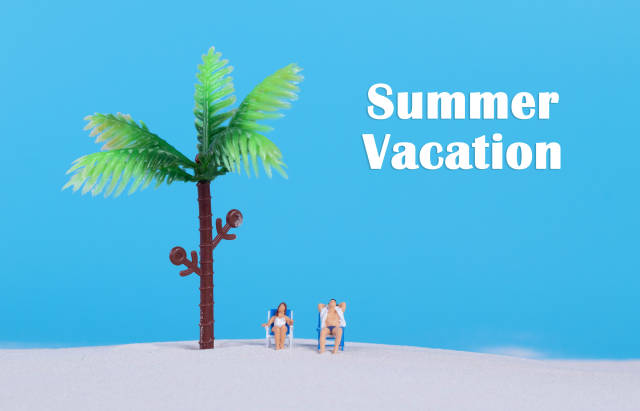 Couple at sandy beach and Summer Vacation text