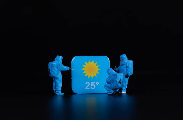 Workers in protective clothes with weather app symbol
