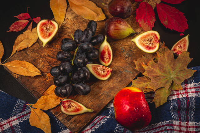 Autumn background with dry leaves and fresh fruit