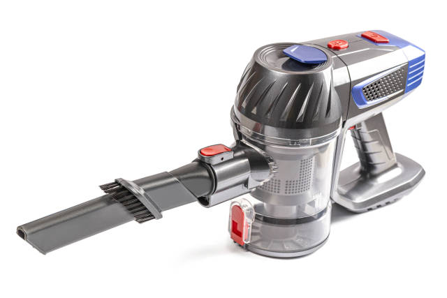 Cordless vacuum cleaner on white background