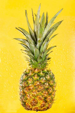 Pineapple tropical fruit on yellow