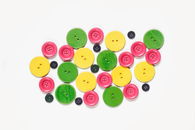 Colorful sewing buttons on white