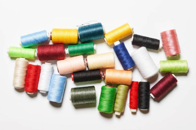 Pile of spools with colorful threads