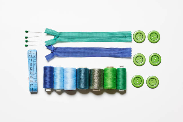 Sewing supplies on white background