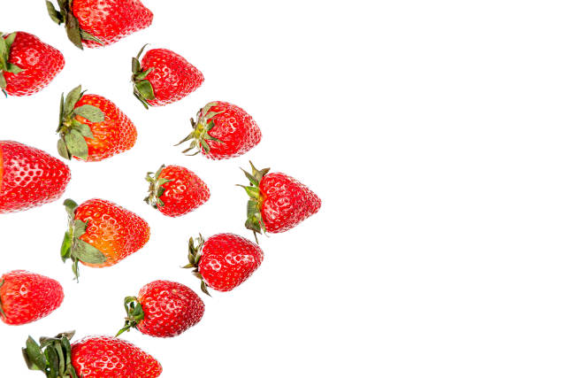Red strawberries lined with triangle on white with free space