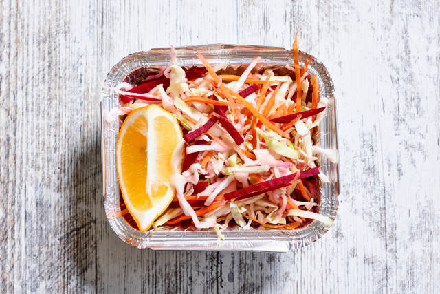 Close-up shot of beetroot and cabbage based dieting salad with a slice of lemon