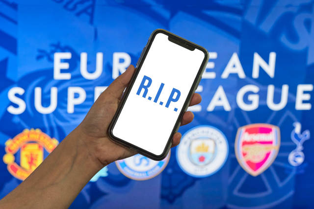 RIP text on the mobile phone screen over European super league banner