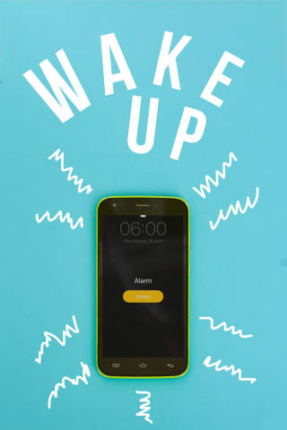 Ringing alarm clock on mobile phone with text - wake up