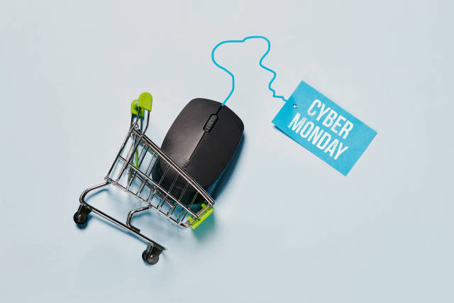 Computer mouse in the shopping cart. Cyber Monday concept