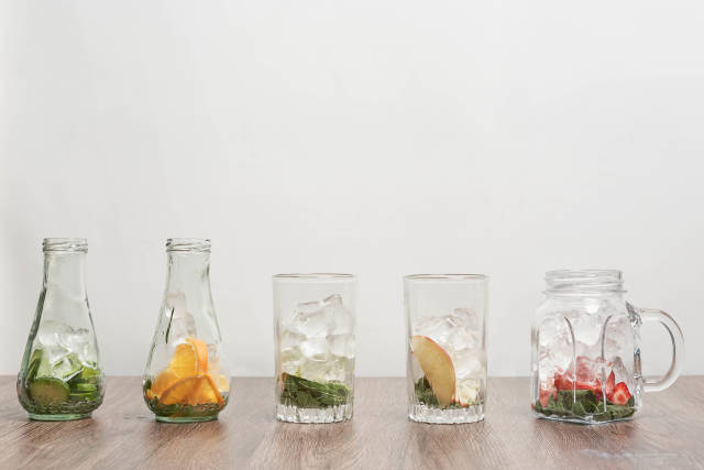 Glasses with different fruits and ingredients for making refreshing cool summer drinks