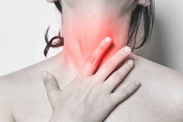 Sore Throat - A woman hands touching her neck