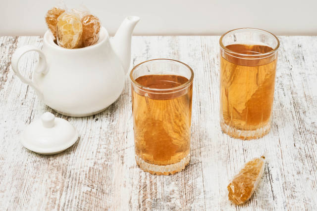 Drinking tea with sweet candies