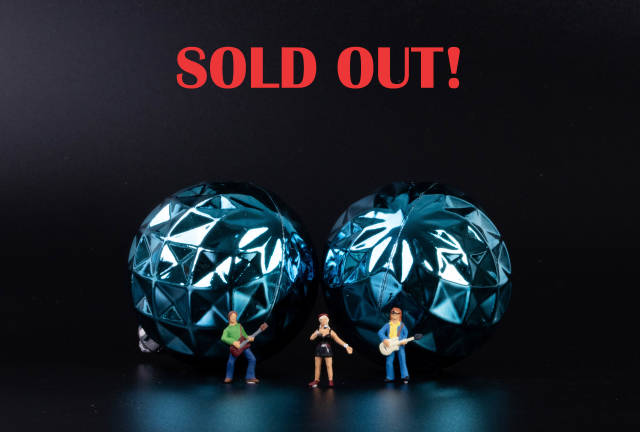 Miniature rock band with Sold out text