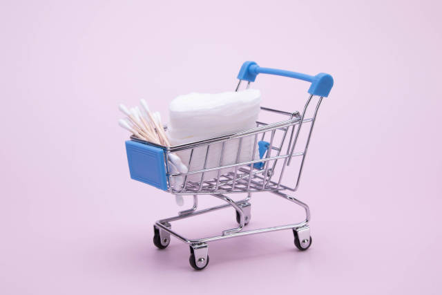Cotton swabs and cosmetic cotton pads in a shopping cart