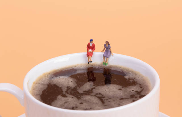 Two girls sitting on hot cup of coffee
