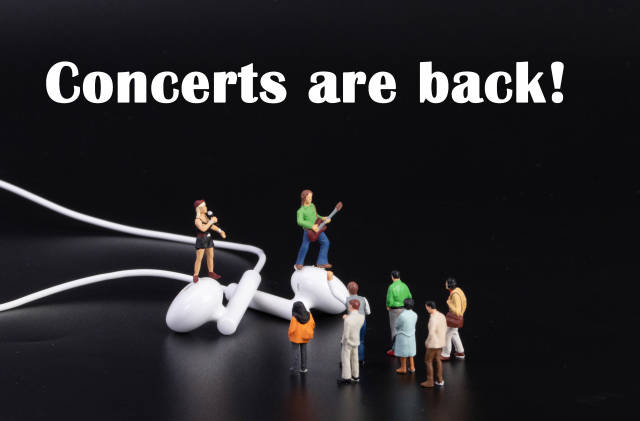 Miniature band with earbuds on black background and concerts are back text