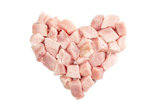 Heart of raw meat slices on white background
