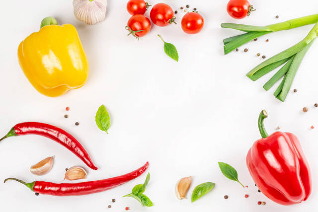 Frame of fresh vegetables and spices on white, top view