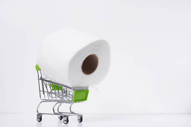 A roll of toilet paper in the shopping cart