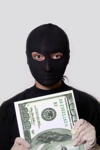 A thief trying to grab money