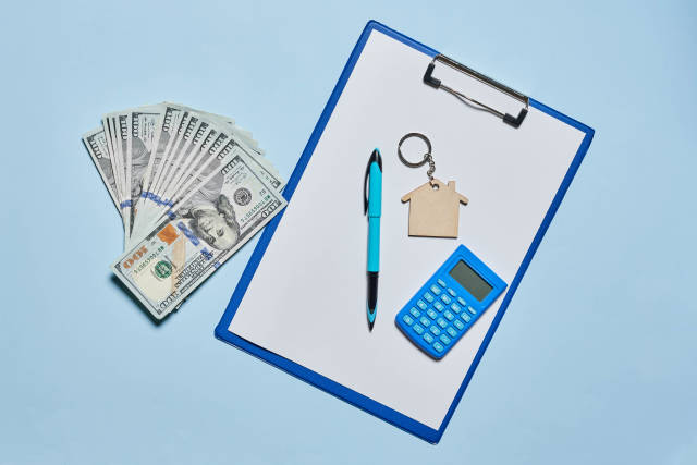 Mortgage calculator - House, money and document.