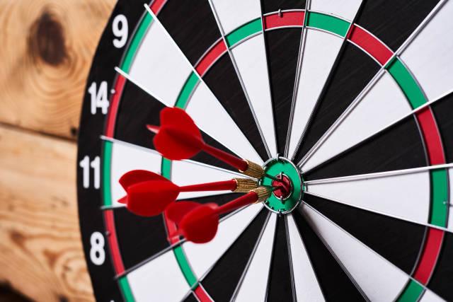 Three arrows in the centre of a dart board