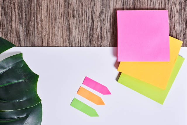 Colorful sticky notes and tags on office desktop