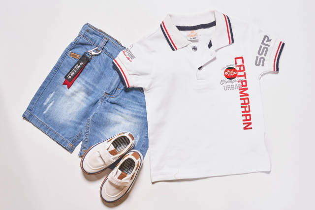 Summer childs cloth set - kids shorts, T-shirt and sneakers white background