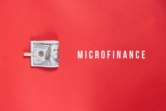 Microfinance concept - Money on red background