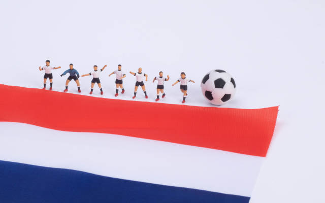 Football players and flag of Netherlands