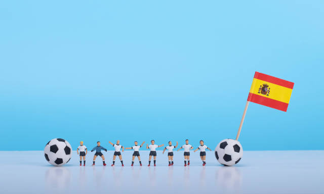 Soccer players with flag of Spain