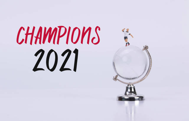 Soccer player standing on a glass globe with Champions 2021 text