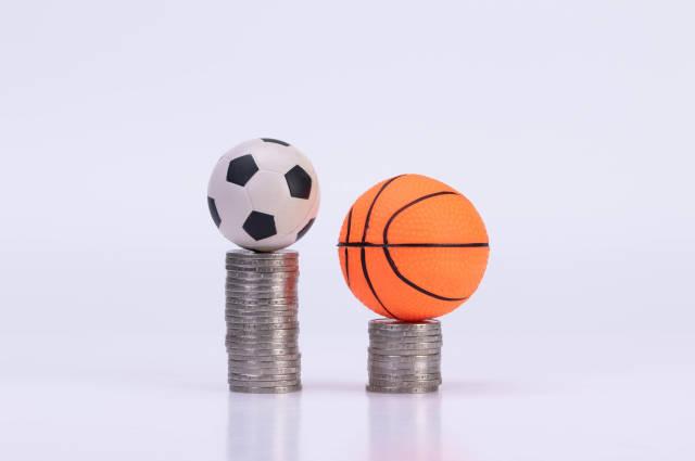 Soccer ball and basketball ball on coinstacks