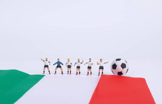 Soccer players with flag of Italy