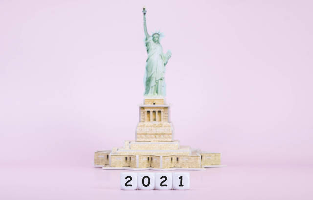 Blocks with 2021 text in front of Statue Of Liberty