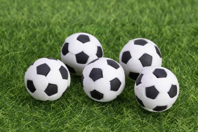Soccer balls on green grass