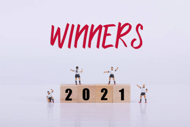 Soccer players standing on wooden cubes with 2021 text and Winners text
