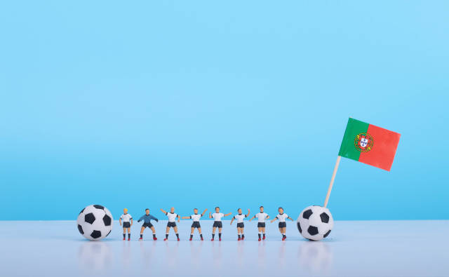 Soccer players with flag of Portugal