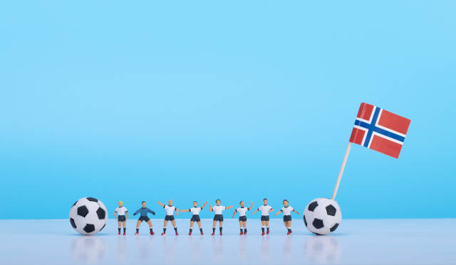 Soccer players with flag of Norway