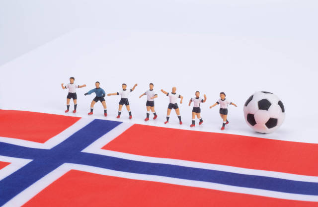 Football players and flag of Norway