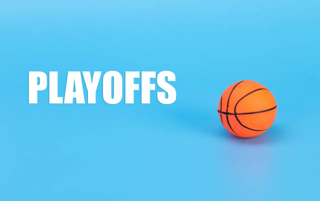 Basketball ball and Playoffs text on blue background
