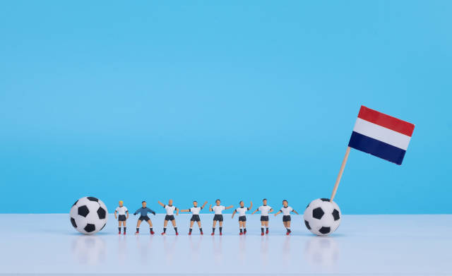 Soccer players with flag of Netherlands