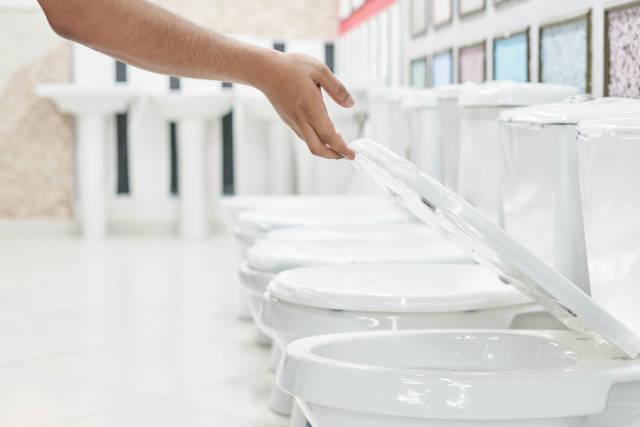 A customer checking and choosing a new toilet bowl