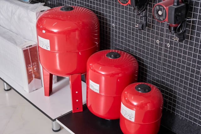 Three sizes of vertical gas pressure tanks in the construction store