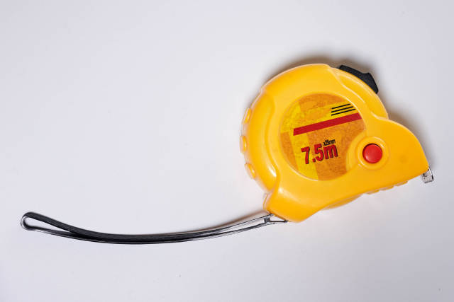 Yellow measuring tape from above