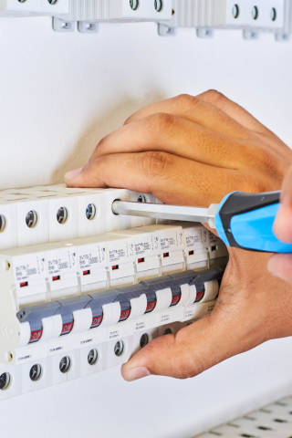A man installing Automatic circuit breakers