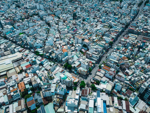 Bird View Drone Photo of a Residential Area with many Houses and interesting Street and Alley System in Ho Chi Minh City, Vietnam